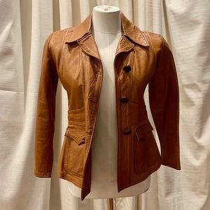 EAST WEST MUSICAL INSTRUMENTS LEATHER JACKET- XS